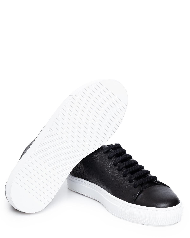 Black suede platform sneaker from Axel Arigato. Shop online